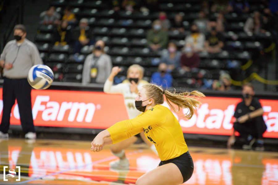 Sophomore Lily Liekweg digs an oncoming attack in WSU's game against Houston on March 26 inside Charles Koch Arena.