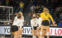Wichita State celebrates after snapping an eight-match losing streak during WSU's game against Houston on March 26 inside Charles Koch Arena.