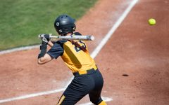 Wichita State sophomore Sydney McKinney looks to swing during the game against ECU at Wilkins Stadium on Mar. 28, 2021.