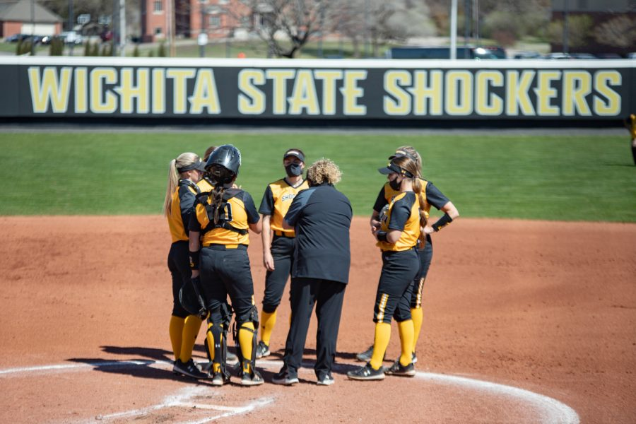 Wichita+State+players+talks+with+head+coach+Kristi+Bredbenner+during+the+game+against+ECU+at+Wilkins+Stadium+on+Mar.+28%2C+2021.