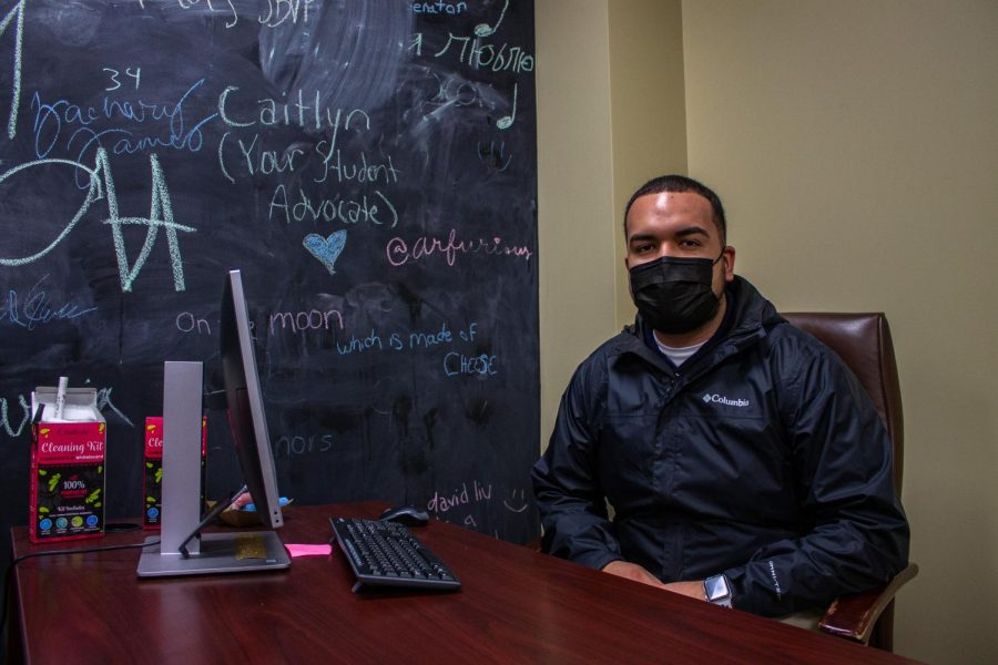 Jonathan Lozano, SGA Director of Health and Wellness, poses at his desk. He was appointed to his current position in October.
