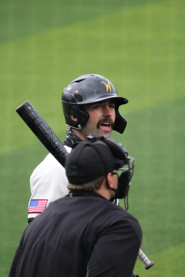 Wichita State senior, Corrigan Bartlett gets ready to step up to bat during a game against Kansas University at Eck Stadium on March 23.