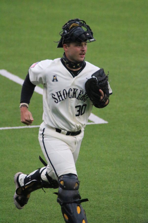 Wichita State freshman, Cooper Harris runs back to home base during a game against Kansas University at Eck Stadium on March 23.