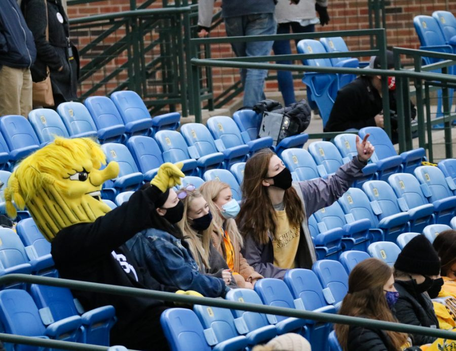 Wichita State baseball fans dance with Wu Shock during a game against Kansas University at Eck Stadium on March 23.