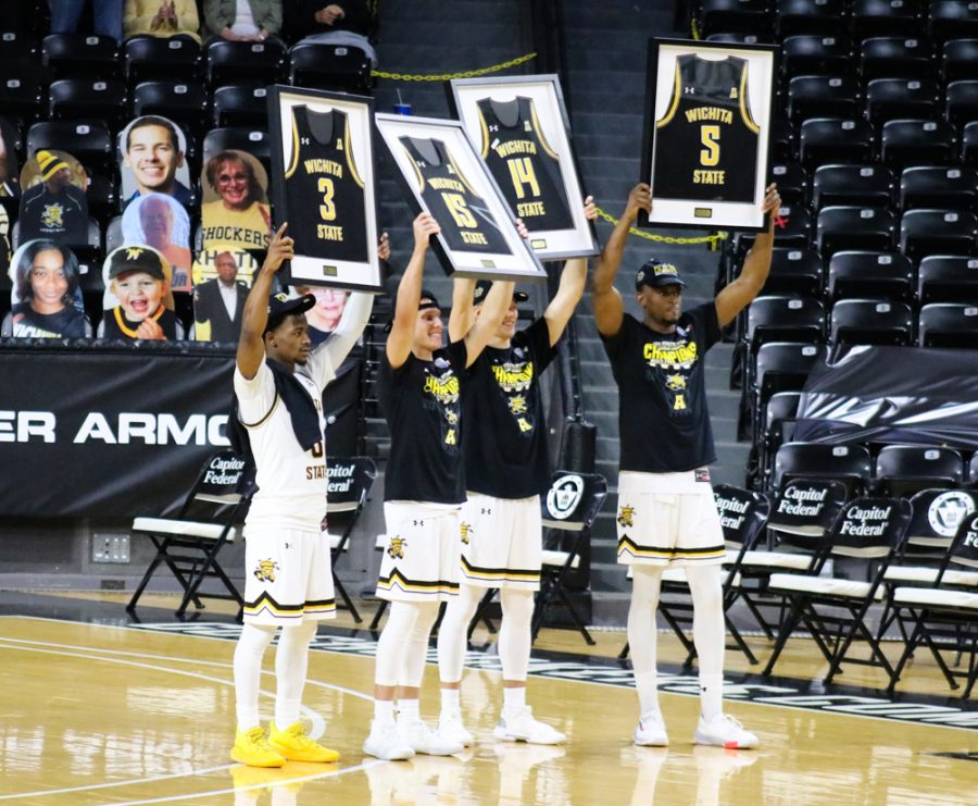 Wichita State seniors pose with their framed jerseys  after a game against South Florida during senior night at Charles Koch Arena on March 6