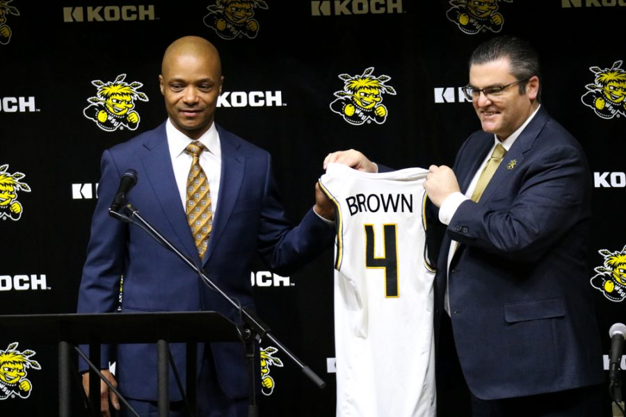 Wichita State's men's basketball coach, Isaac Brown poses with athletic director, Darron Boatright during Brown's coaching inauguration at Charles Koch Arena on March 1.