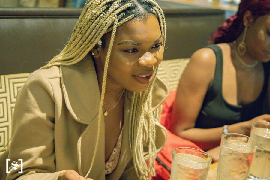 Wichita State Senior Lucia Agbor is hanging out with friends at YaYas Euro Bistro on April 25, 2021.