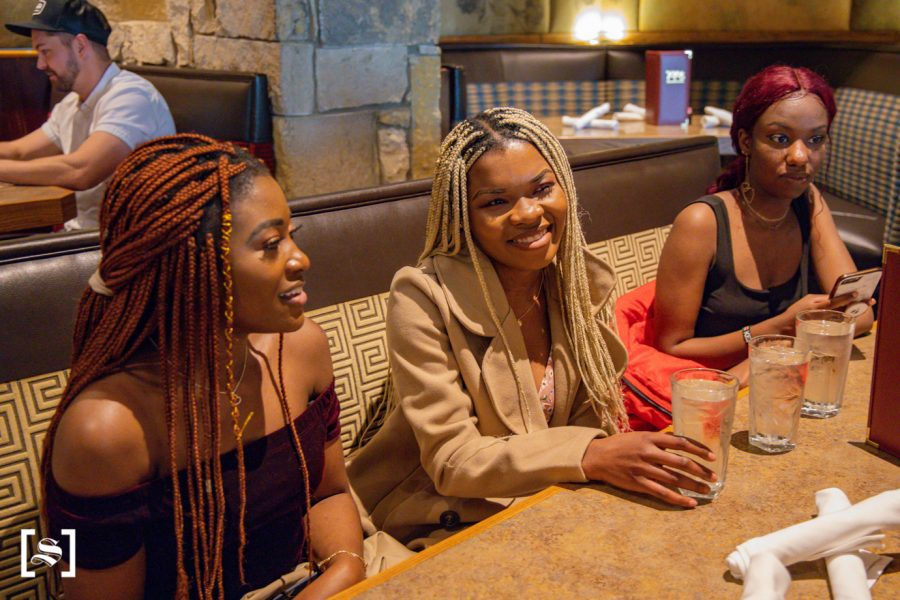 Wichita State Senior Lucia Agbor hangs out with friends at YaYas Euro Bistro on April 25, 2021.