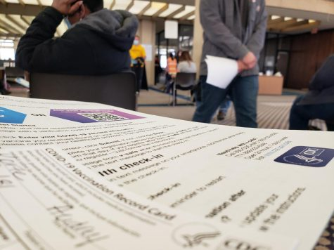 Check-in papers and a COVID-19 fact sheet greet Sedgwick County residents at the COVID vaccination site in downtown Wichita.