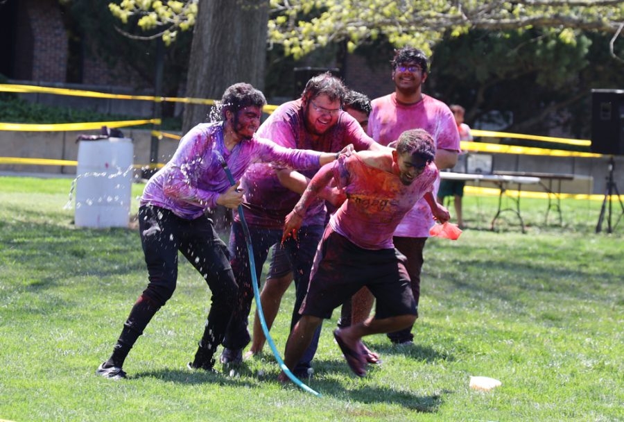 Studnts playing with water at Holli hosted by AHINSA at Hubbard Hall Lawn on April 24, 2021.