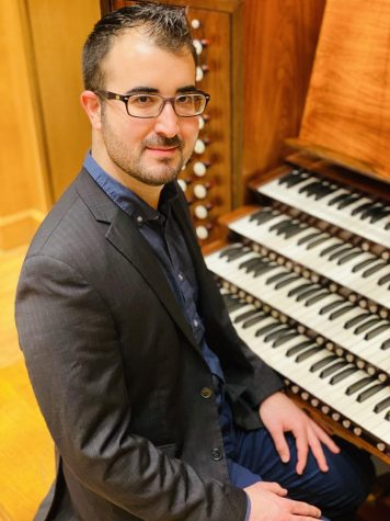David Perez sits in front of his passion, the organ. He is a graduate student looking for a life of playing the organ.