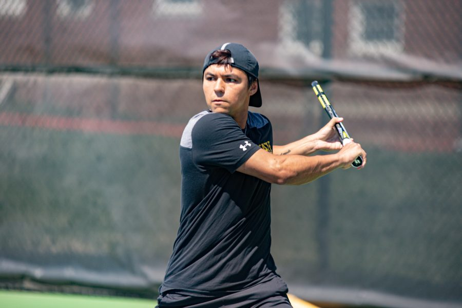 Wichita+State+Redshirt+Sophomore+Nicolas+Acevedo+returns+the+ball+during+the+game+against+the+SMU+Mustangs+at+the+Coleman+Tennis+Complex+on+April+2%2C+2021.