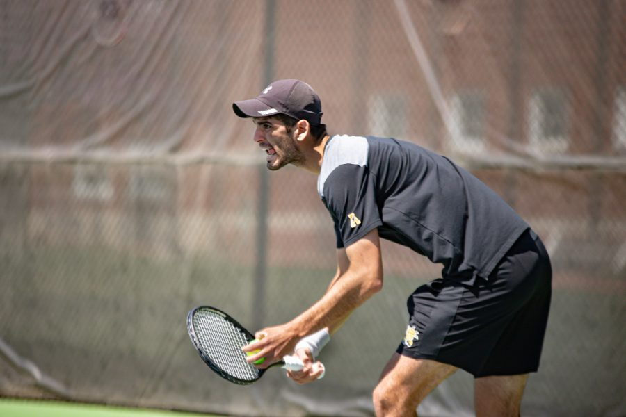 Wichita State Redshirt Sophomore Stefan Latinovic looks to serve during the game against the SMU Mustangs at the Coleman Tennis Complex on April 2, 2021.
