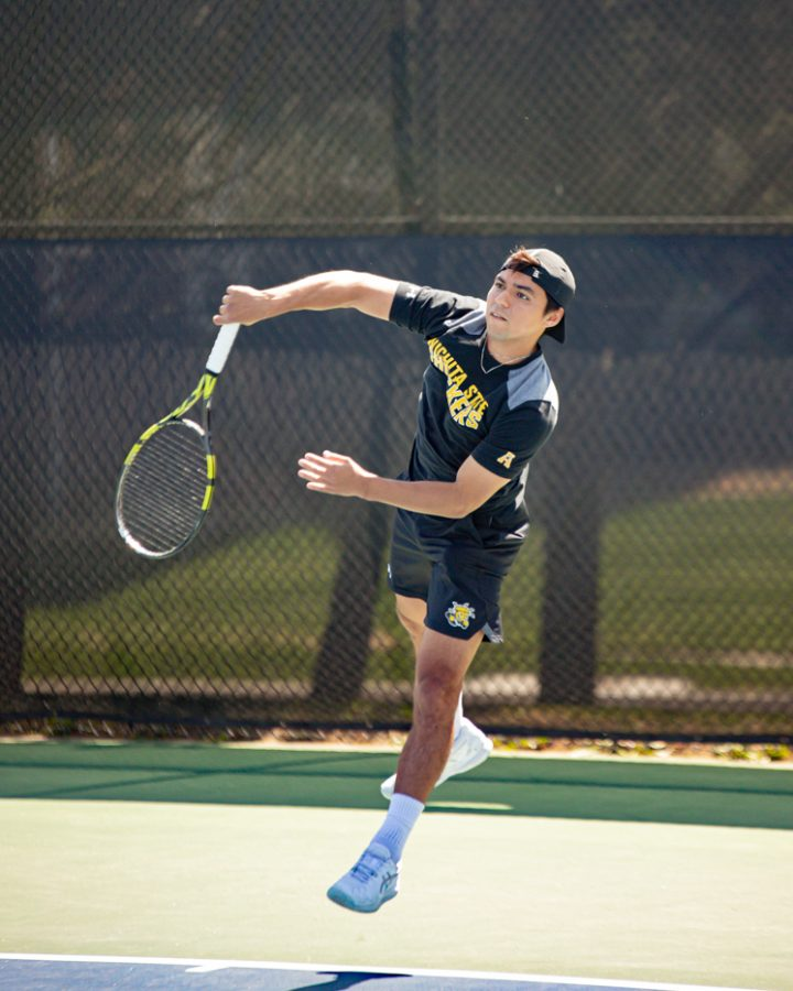 Wichita State Redshirt Sophomore Nicolas Acevedo returns the ball during the game against the SMU Mustangs at the Coleman Tennis Complex on April 2, 2021.