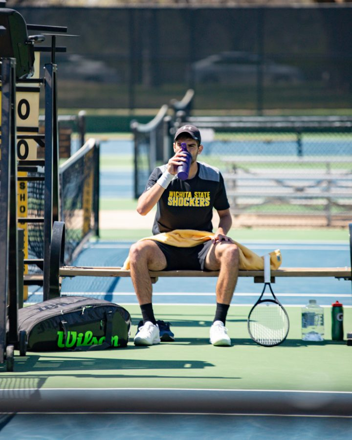 Wichita State Redshirt Sophomore Stefan Latinovic rests during the game against the SMU Mustangs at the Coleman Tennis Complex on April 2, 2021.