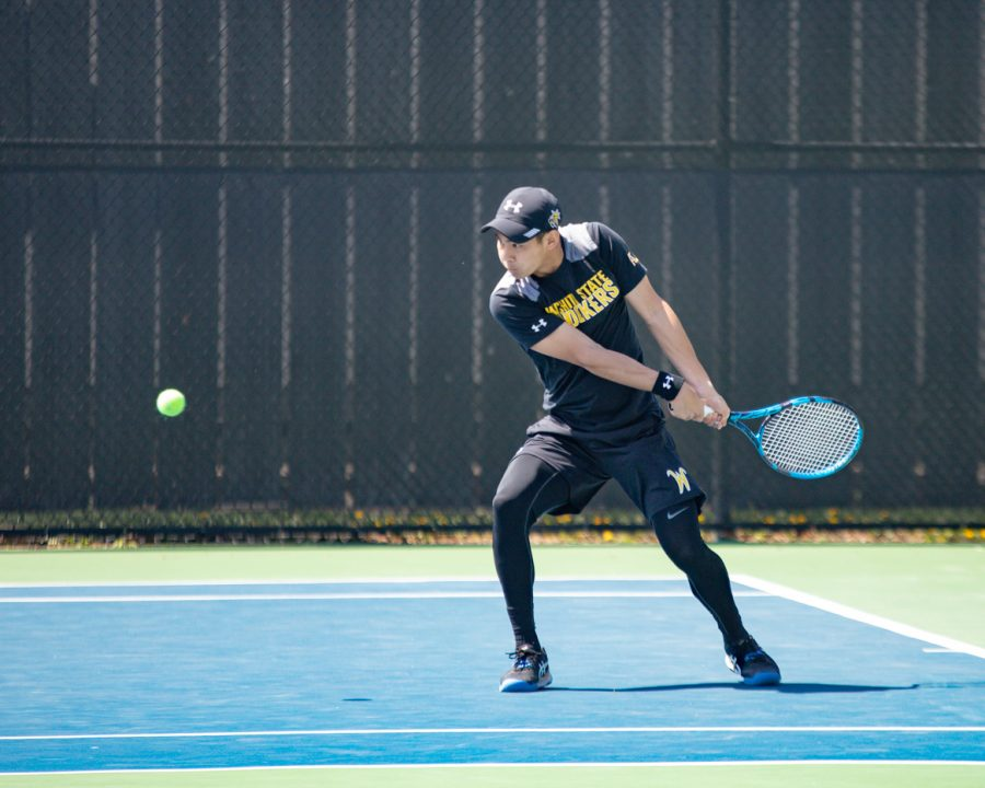 Wichita State Redshirt Freshman Ray Lo returns the ball during the game against the SMU Mustangs at the Coleman Tennis Complex on April 2, 2021.