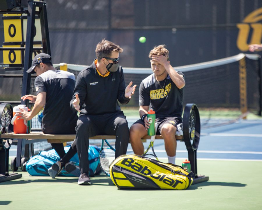 Wichita State Redshirt Sophomore Orel Ovil listens to the coach during the game against the SMU Mustangs at the Coleman Tennis Complex on April 2, 2021.