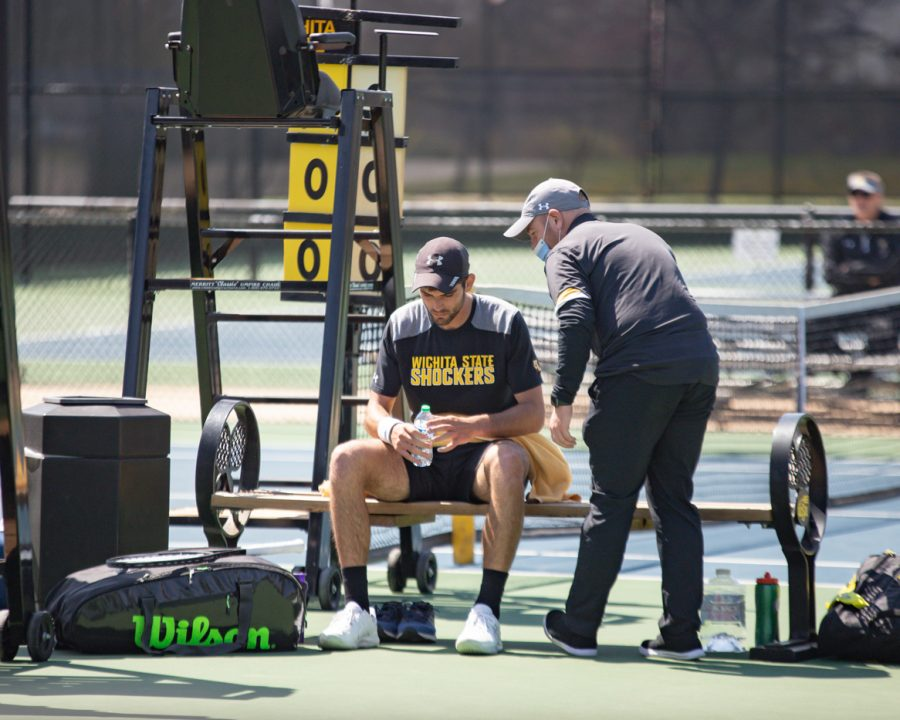 Wichita State Redshirt Sophomore Stefan Latinovic listens to the coach during the game against the SMU Mustangs at the Coleman Tennis Complex on April 2, 2021.
