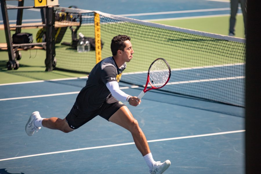 Wichita State Redshirt Senior Murkel Dellien returns the ball during the game against the SMU Mustangs at the Coleman Tennis Complex on April 2, 2021.
