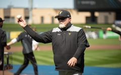 Head coach Eric Wedge throw a pitch during Wichita States practice on April 8 at Riverfront Stadium.