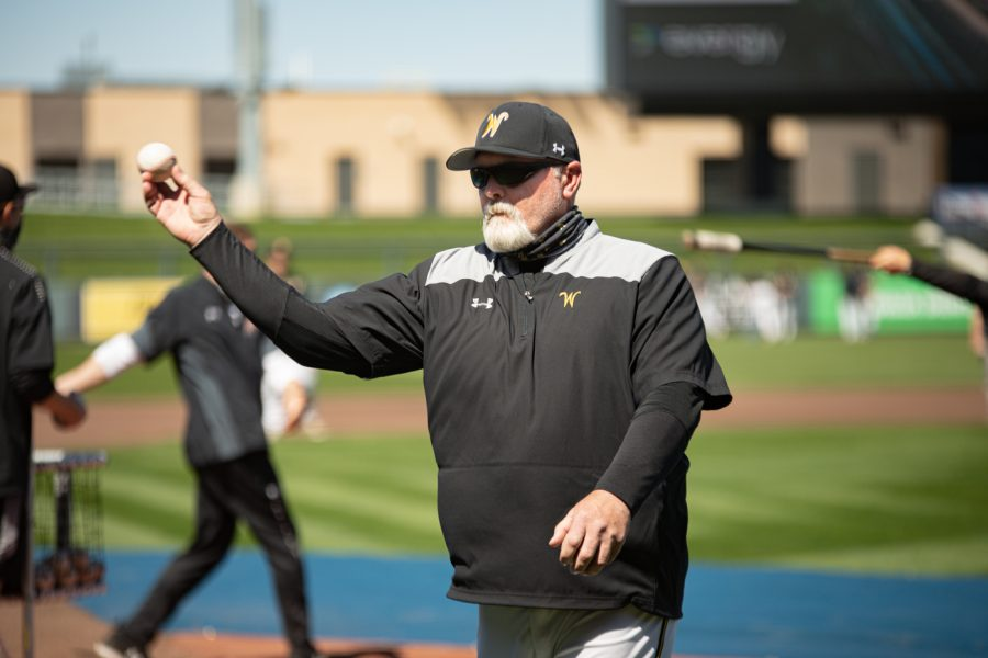 Head coach Eric Wedge throw a pitch during Wichita State's practice on April 8 at Riverfront Stadium.