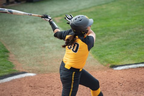 Wichita State senior Madison Perrigan hits a grand slam during the game against Houston at Wilkins Stadium on April 9, 2021.