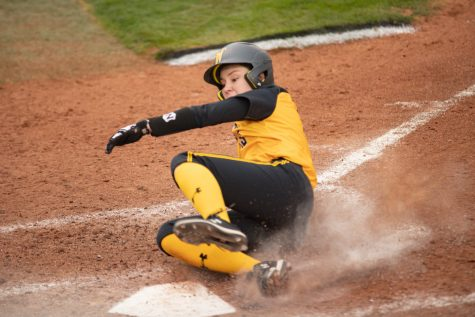 Wichita State junior Bailee Nickerson slides onto homebase during the game against Houston at Wilkins Stadium on April 9, 2021.