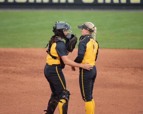 Wichita State senior Bailey Lange and Wichita State senior Madison Perrigan  strategize durring the game against Houston at Wilkins Stadium on April 9, 2021.