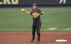 Wichita State sophomore Sydney McKinney throws the ball during the game against Oklahoma State at Wilkins Stadium on April 27, 2021.