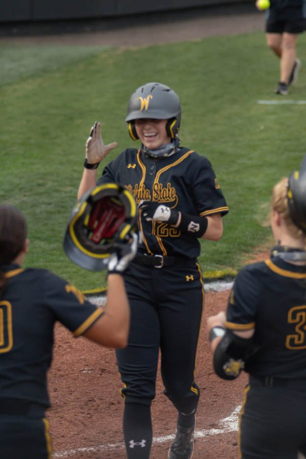 Wichita State sophomore Sydney McKinney celebrates a home run during the game against Oklahoma State at Wilkins Stadium on April 27, 2021.