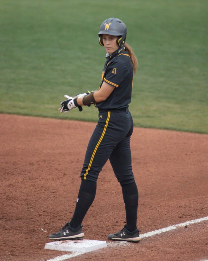 Wichita State junior Neleigh Herring stands at first base during the game against Oklahoma State at Wilkins Stadium on April 27, 2021.