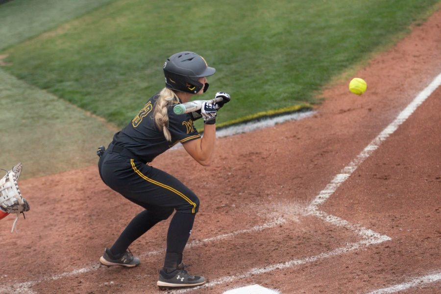 Wichita State senior Ryleigh Buck hits the ball during the game against Oklahoma State at Wilkins Stadium on April 27, 2021.
