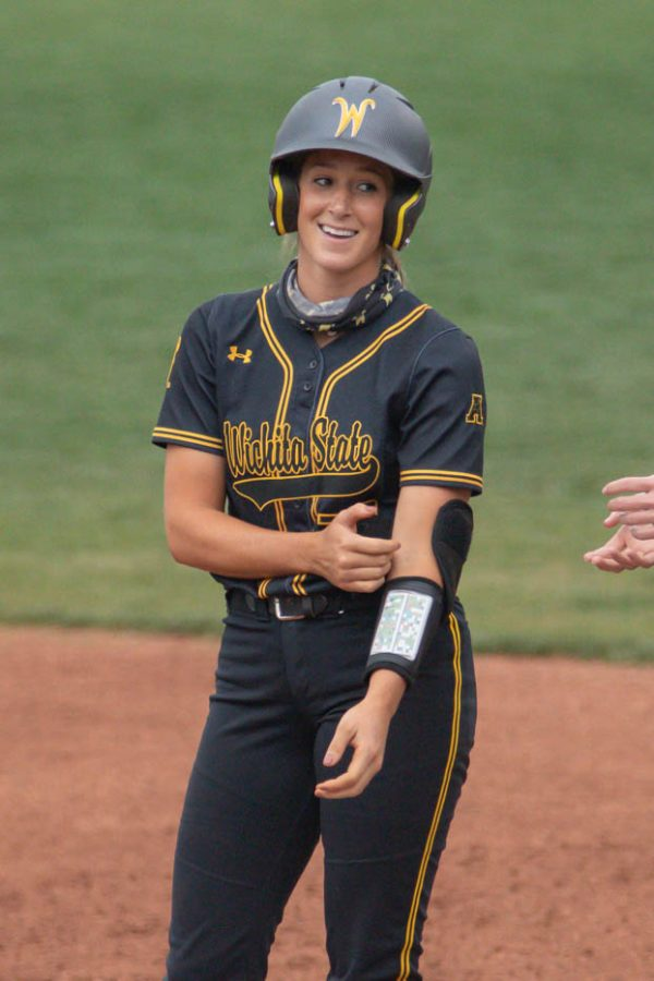 Wichita State redshirt senior Kaylee Huecker makes it to first base during the game against Oklahoma State at Wilkins Stadium on April 27, 2021.