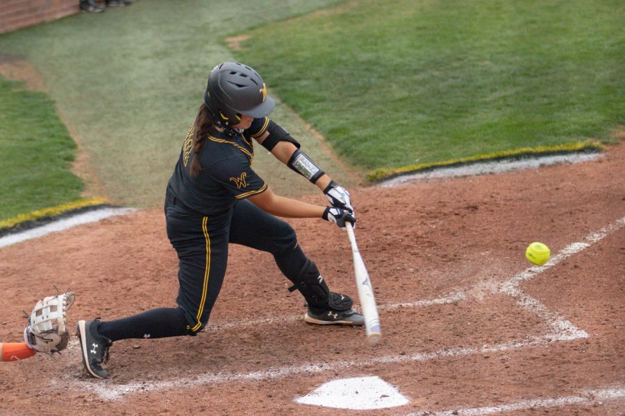 Wichita State senior Madison Perrigan hits the ball during the game against Oklahoma State at Wilkins Stadium on April 27, 2021.