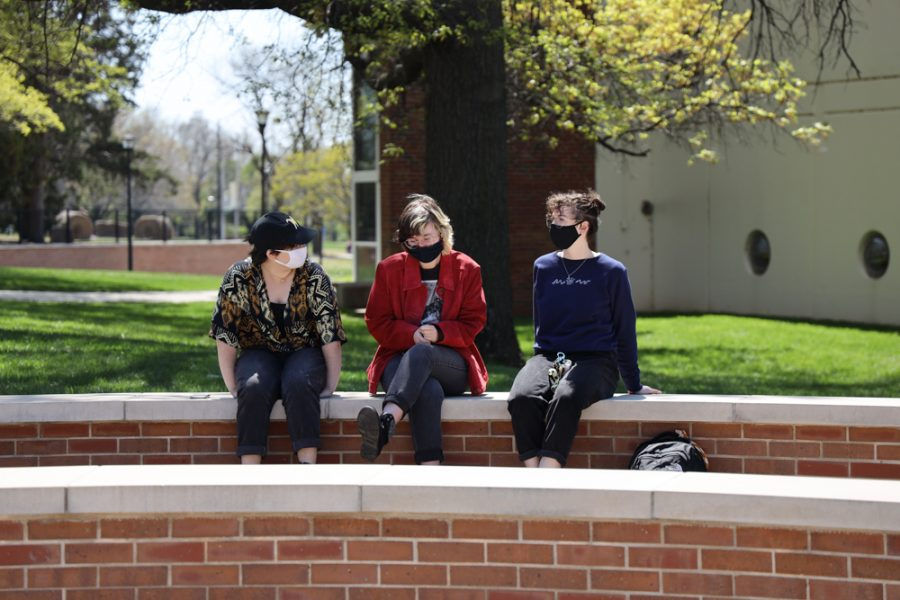 Wichita State students ambassadors sophomore Meg Gonzalez  majoring  in music ed, junior Gray Lovette majoring in animation, and junior Daria Moore majoring in biological sciences at the launch of Belonging Plaza on April 24, 2021 east of Wiedemann Hall. Meg stated