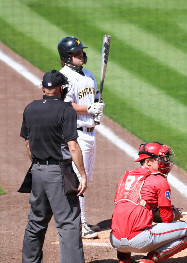 Wichita State junior, Paxton Wallace prepares himself before stepping up to the base during a game against Houston at Riverfront Stadium on April 10.