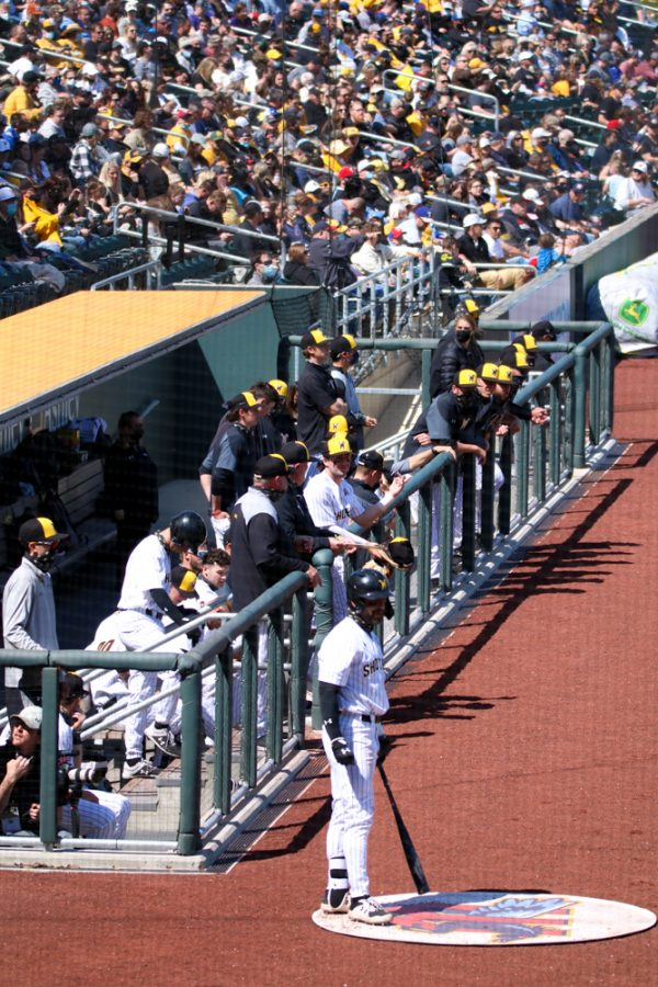 The Shockers cheer for their team during a game against Houston at Riverfront Stadium on April 10.