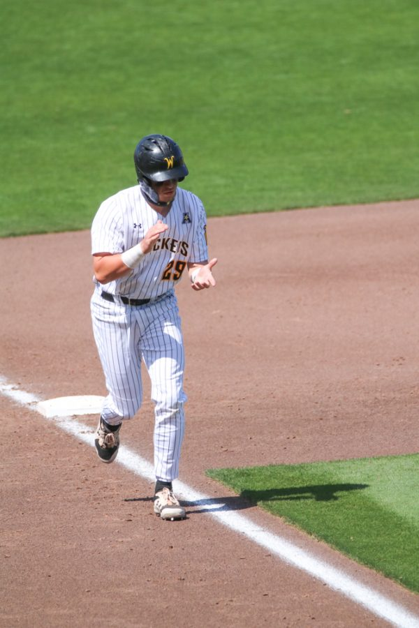 Wichita State junior, Garrett Kocis celebrates by claping on his way to home base during a game against Houston at Riverfront Stadium on April 10.