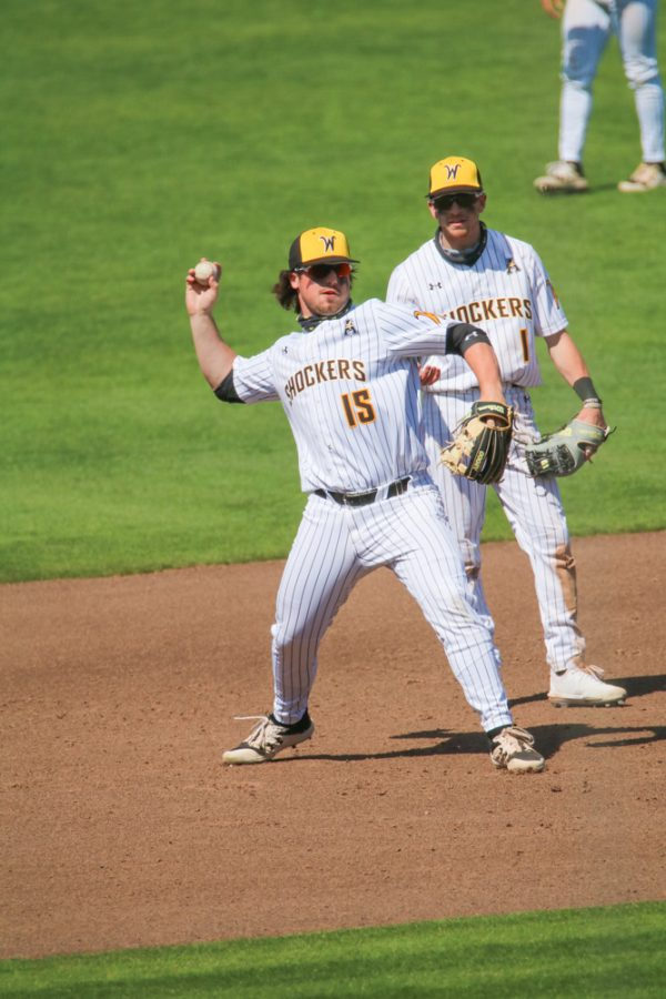 Wichita State junior, Paxton Wallace throws the ball during a warm up before a game against Houston at Riverfront Stadium on April 10.
