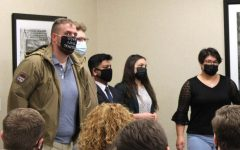 Samuel McCrory, left, is sworn in as a returning adult Student Government Association senator on April 22, 2021. His white lives matter mask sparked controversy online.