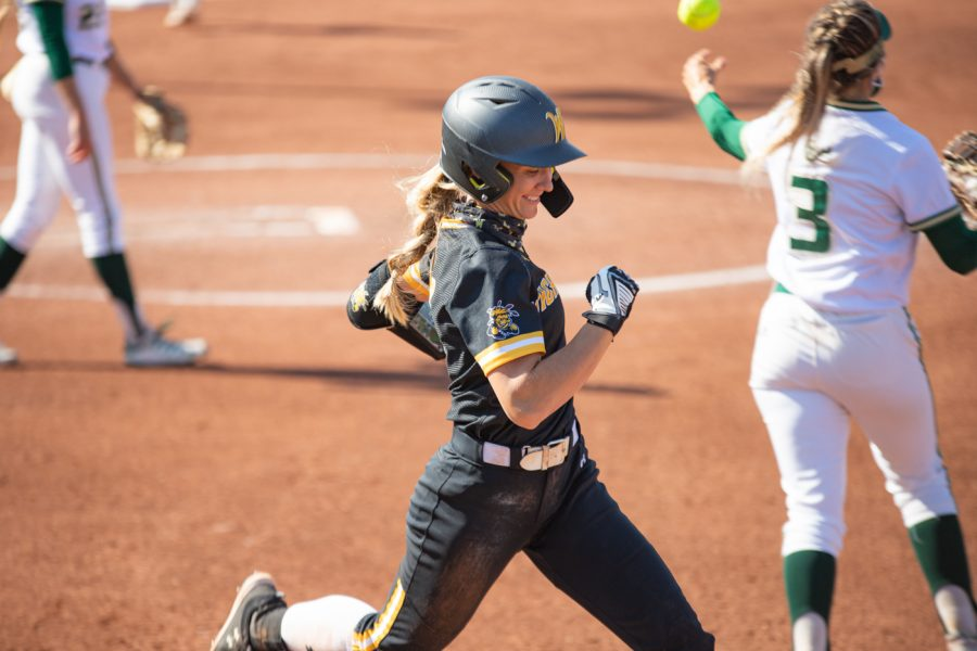 Wichita State senior Ryleigh Buck runs to first base during the game against South Florida at Wilkins Stadium on April 24, 2021.