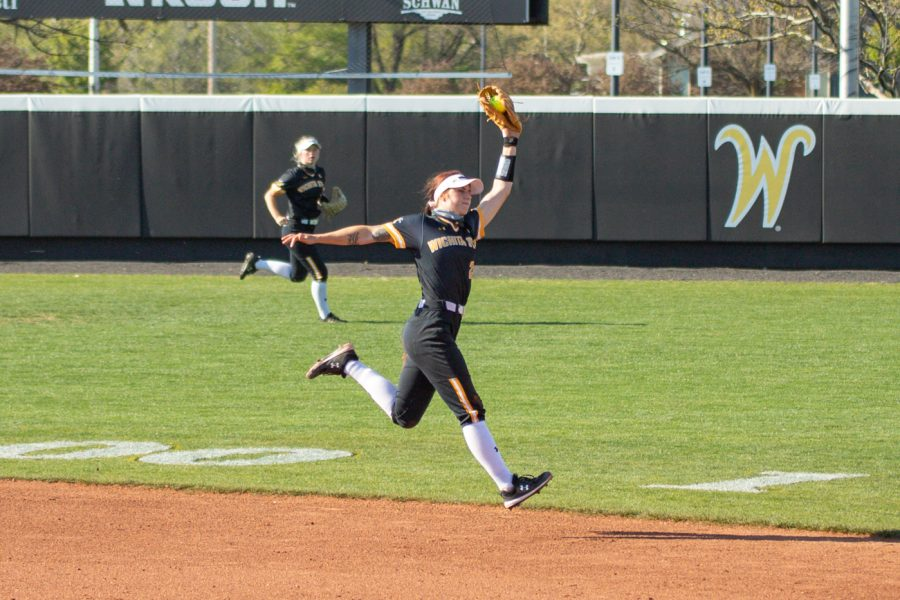 Wichita State sophomore Sydney McKinney catches the ball during the game against South Florida at Wilkins Stadium on April 24, 2021.