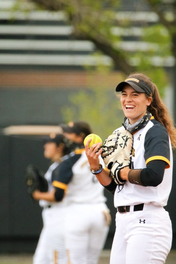 Wichita State junior, Neleigh Herring smiles at teammate during a game against USF at Wilkins Stadium on April 23.