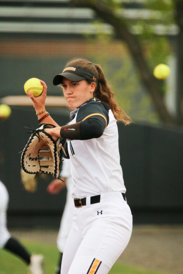 Wichita State junior, Neleigh Herring throws the ball while warming up during a game against USF at Wilkins Stadium on April 23.