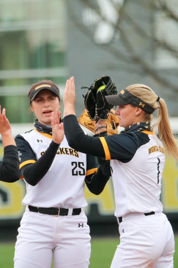 Wichita State sophomore, Sydney Mckinney and senior, Bailey Lange high five during a game against USF at Wilkins Stadium on April 23.