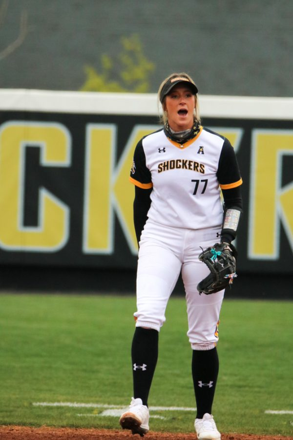 Wichita State senior, Kaylee Huecker yells at her teammates in celebration during a game against USF at Wilkins Stadium on April 23.