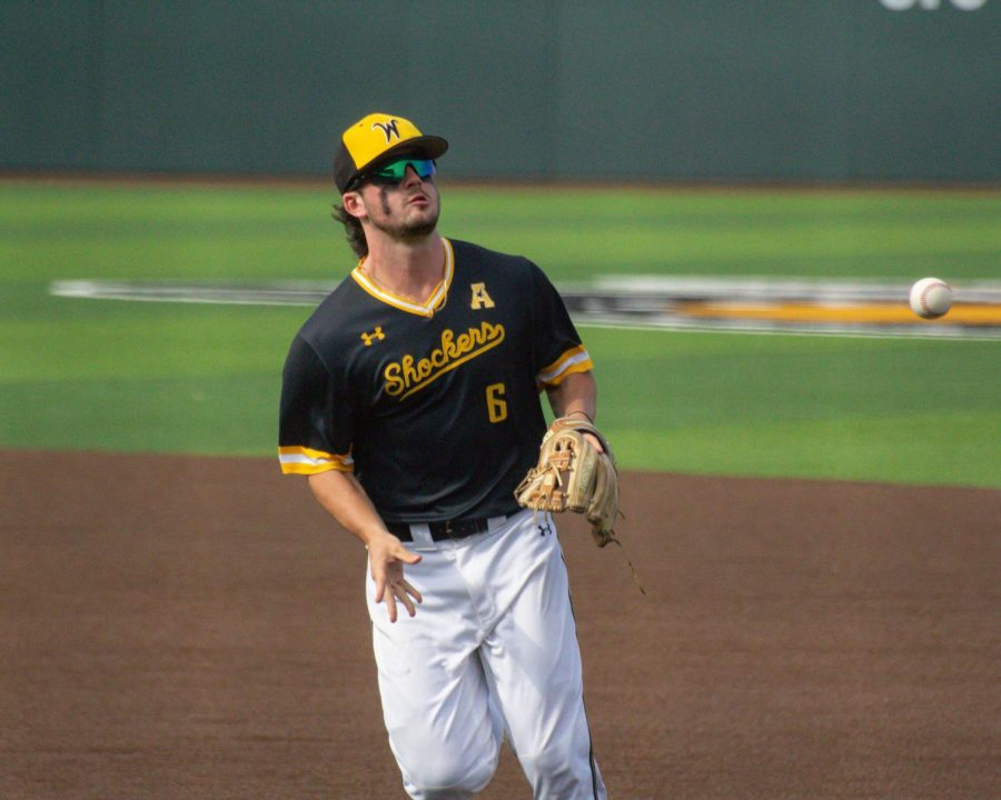 Sophomore Jack Sigrist tosses the ball over to first base during Wichita State's game against South Florida on Saturday, May 14 inside Eck Stadium.