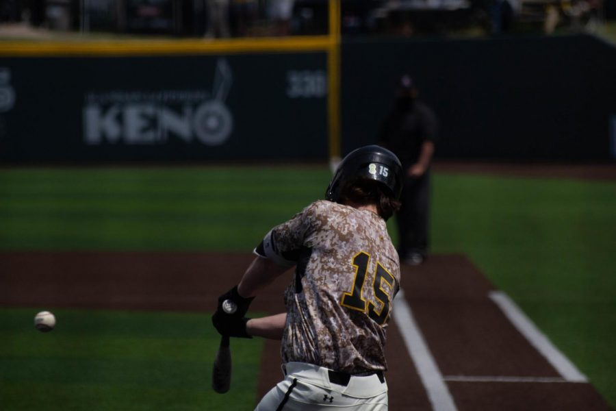 Junior Paxton Wallace takes a swing during Wichita State's game against South Florida on Saturday, May 15 inside Eck Stadium.