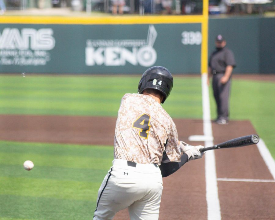Freshman Couper Cornblum takes a swing during Wichita State's game against South Florida on Saturday, May 15 inside Eck Stadium.