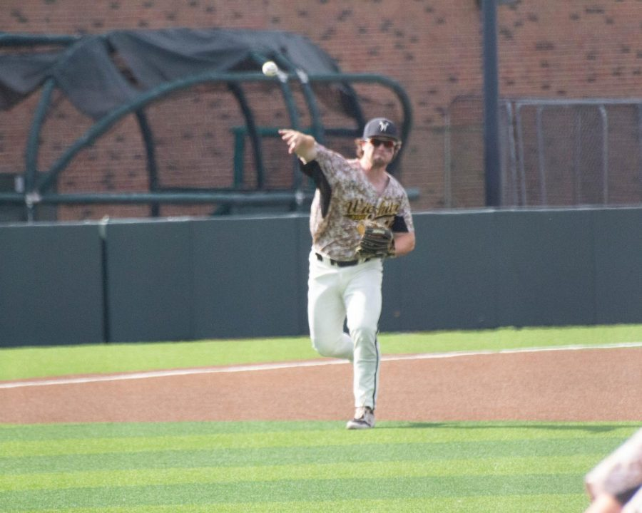 Junior Paxton Wallace throws the ball towards first base during Wichita State's game against South Florida on Saturday, May 15 inside Eck Stadium.